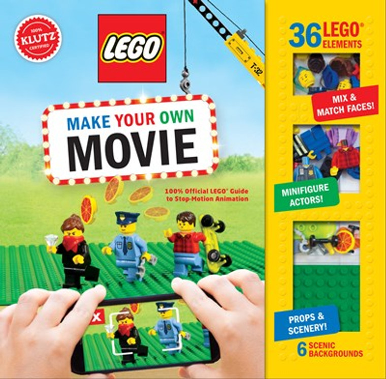 This image shows a book with some Lego figures being filmed with a phone.  Along the side is a clear panel showing some Lego figures.