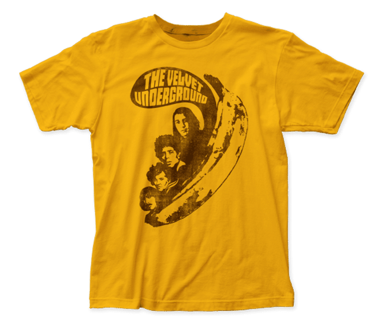 """A mustard yellow t-shirt with four people emerging from a banana with a word bubble above them that says """"The Velvet Underground"""""""