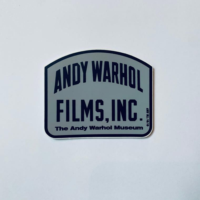 """Image of a tombstone shaped grey sticker that reads """"Andy Warhol Films Inc."""""""
