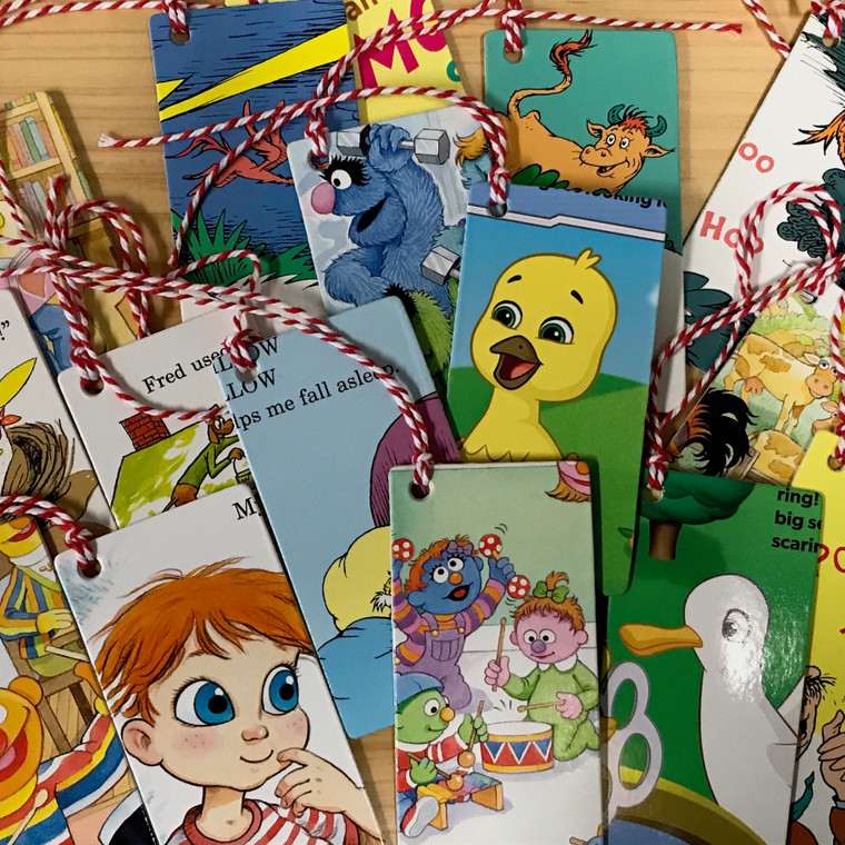 """Assorted bookmarks recycled from library and school books,  2""""X4""""."""