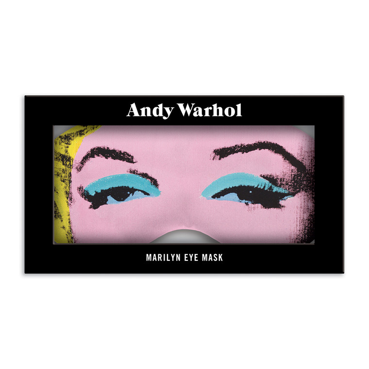 A sleep mask with a detail of eyes from a Warhol Marilyn artwork in a  black box