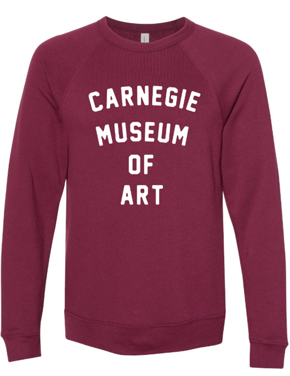 Adult CMOA Logo Crewneck Sweater available in Maroon with White Lettering. A soft fleece, tri-blend. Pre-shrunk. Standard fit.