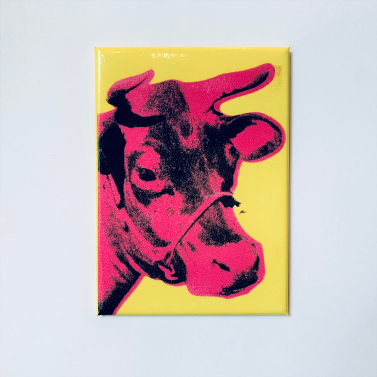 Image of a rectangular magnet with a pink cow on a yellow background.