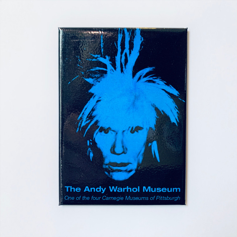 Image of a rectangular magnet depicting a blue Andy Warhol in a wig with hair standing on end.