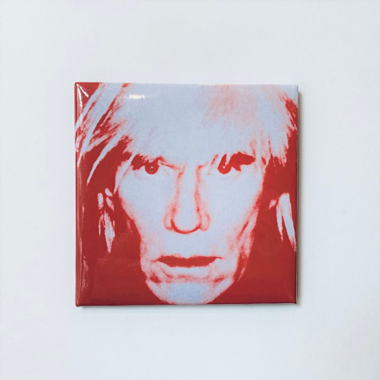 Image of a square magnet depicting a red Andy Warhol in a wig, staring straight into your soul.
