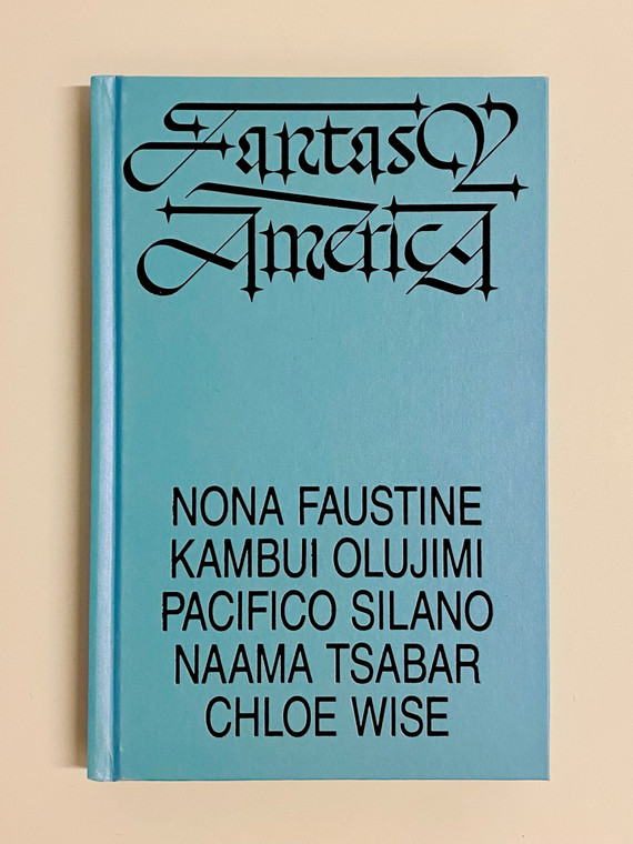 """A pale blue book cover with black script that reads """"Fantasy America"""""""