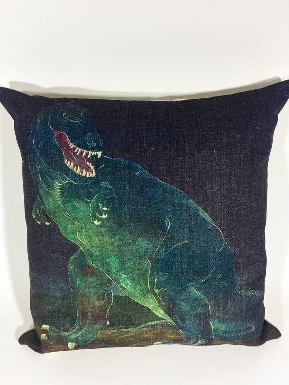 """18""""x18"""" denim blue pillow cover with a full front mural of Tyrannosaurs Rex by Ottmar Von Fuehrer, 1950."""