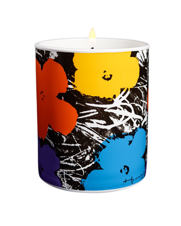 A porcelain candle holder with red, yellow, blue and purple flowers on a black and white background