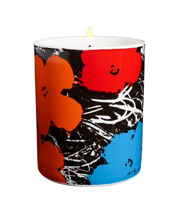 A porcelain candle holder with red, orange and blue flowers on a black and white background.