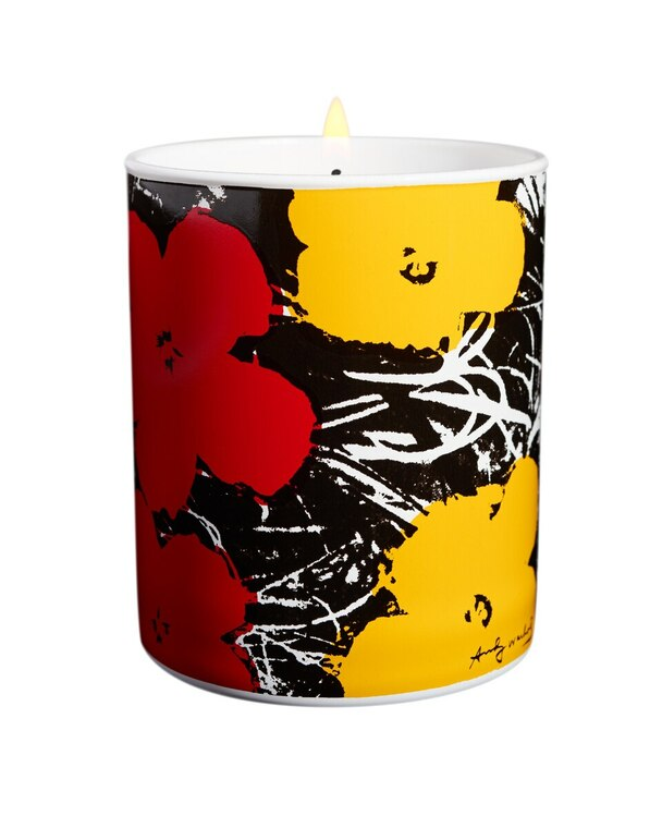 A porcelain candle holder with red and yellow flowers on a black and white background