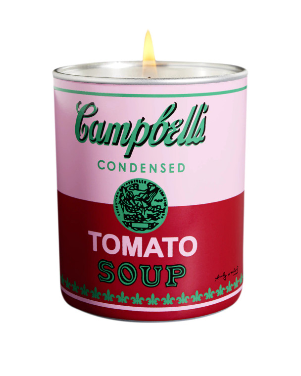 A porcelain candle holder with a pink and red soup label
