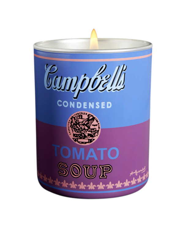 A porcelain candle holder with a blue and purple soup can label