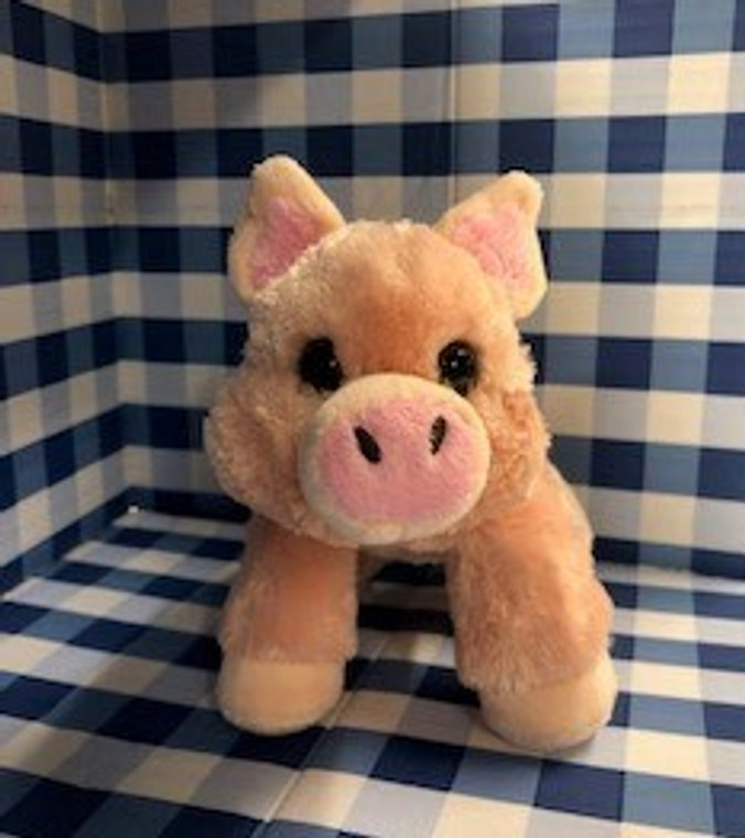 This image shows a realistic soft plush pink pig. This stuffed Pig will make you smile.