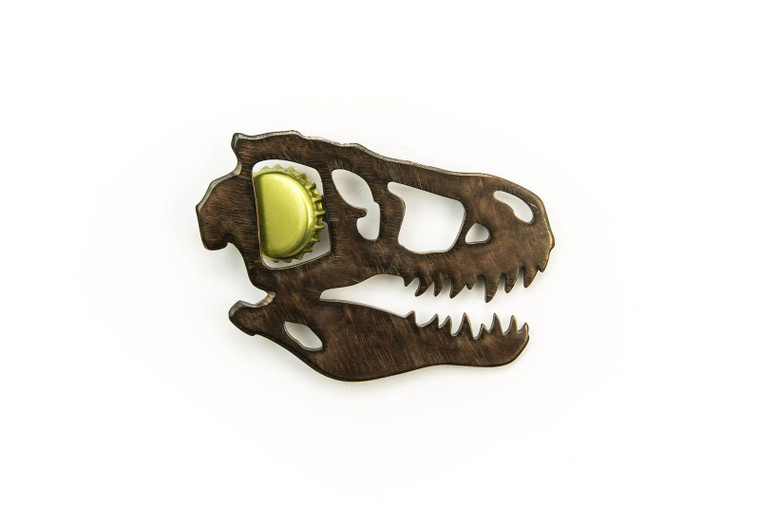 This image shows a metal bottle opener cut out in the shape of a T-Rex skull