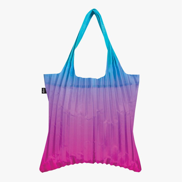 Image of a pleated ombre tote bag that fades from blue to magenta.