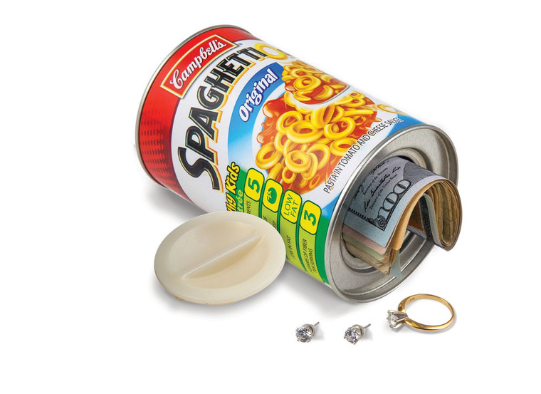 Image of a tipped over empty can of SpaghettiOs with a hole in the bottom, and cash and jewelry spilling out. Cap that closes the contents inside is beside said can.