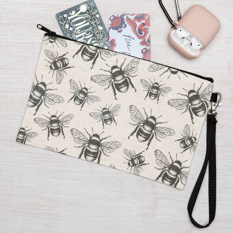 The Honey Bee wristlet is perfect for many uses. Linen Zipper Pouch is the perfect pencil pouch, cosmetic bag, or coin purse. Perfect as a travel pouch, organize stuff like earrings, earphones, business cards, paper money, keys, and small cosmetic items.