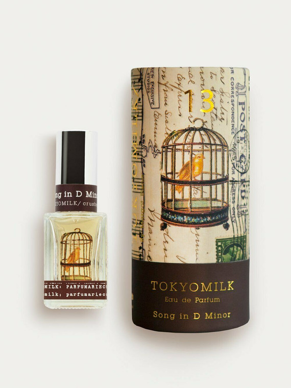 A decorated cylinder box with an image of a delicate bird in cage. Fragrance Notes A complex melody: White Orchid, Orange Flower, Gardenia & Amber