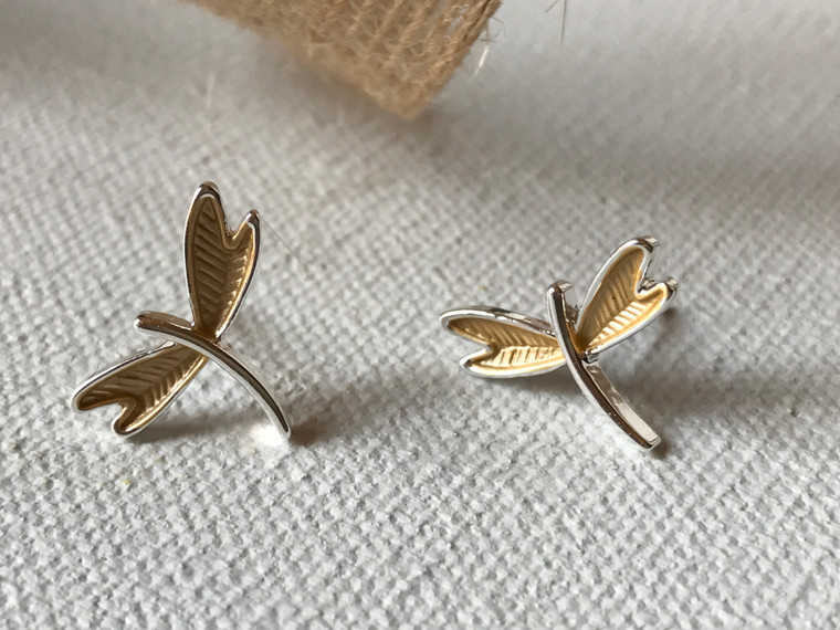 Dragonfly post earrings are accented in gold & silver tones while the Larger version makes a statement all on its own in a solid silver-tone finish.