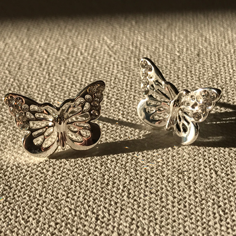 Adorable light & airy… these silver tone butterfly earrings come with two sets of backings: a wonderful pair of diskies as well as rubber stoppers.  100% hypoallergenic.  Completely lead free, nickel free and cadmium free.