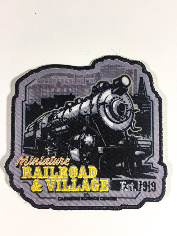 This image shows an iron on patch with an irregular shape showing the Miniature Railroad and Village image in black and beige, with Carnegie Science Center logo.