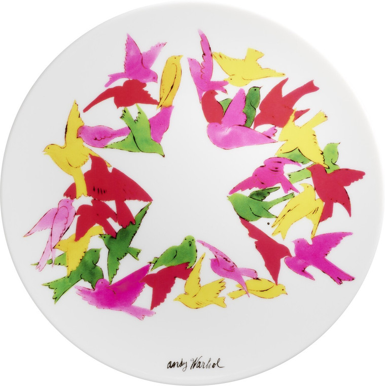 A plate with a drawing of birds arranged around a start shape in the center.