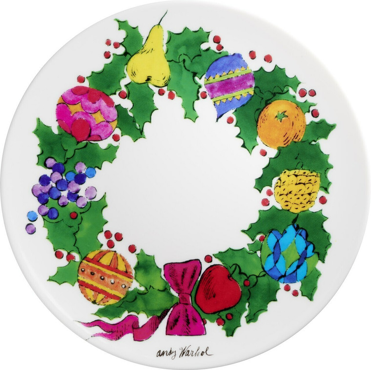 A plate with a drawing of a wreath with holly and fruits.
