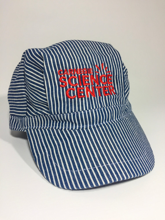 This image is of a blue and white striped railroad hat.  It has a red Carnegie Science Center Log on the front and a plastic adjustable strap on the back.