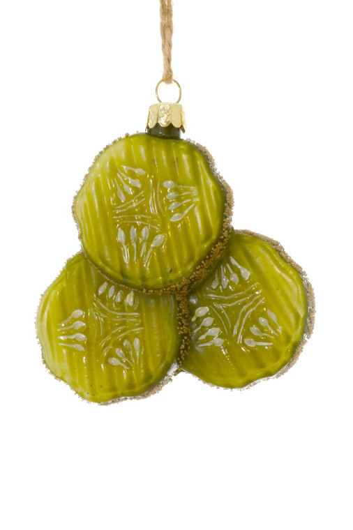 Image of an ornament with three green slices of pickles.