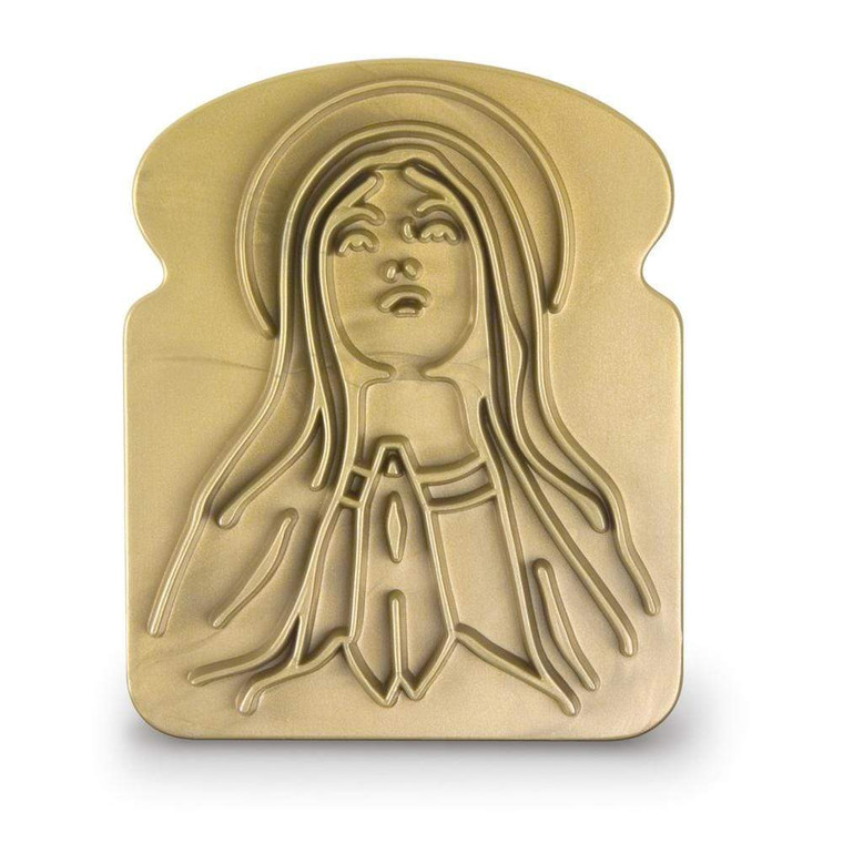 Image of a gold bread shaped piece of plastic with the Virgin Mary gazing upward.