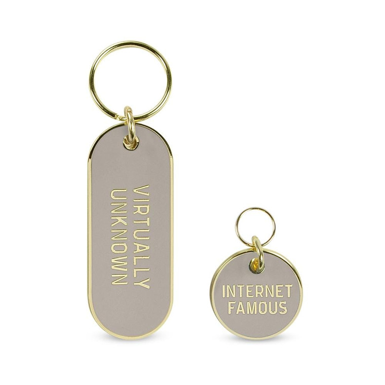 Image of a gold and grey keychain and matching pet tag.
