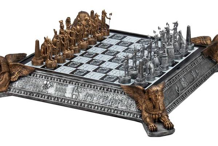 Gold and silver Egyptian chess set with decorative chessboard. Chessboard with Sphinx on four sides also serve as storage for the chessmen.