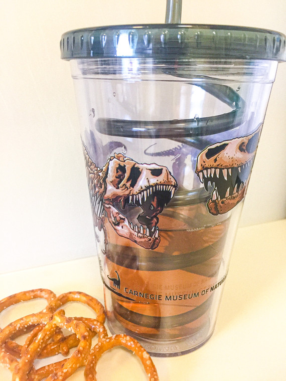 T-Rex head to head decal on acrylic tumbler with CMNH logo.