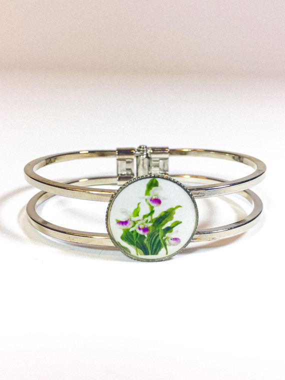 Rhodium plated copper cuff  with hinge closure, alloy metal charm with  Lady Slipper image.