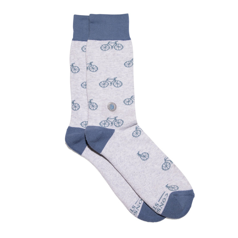 Supply books to kids with these fun bicycle themed socks featuring a blue design on gray plus a book embroidery.