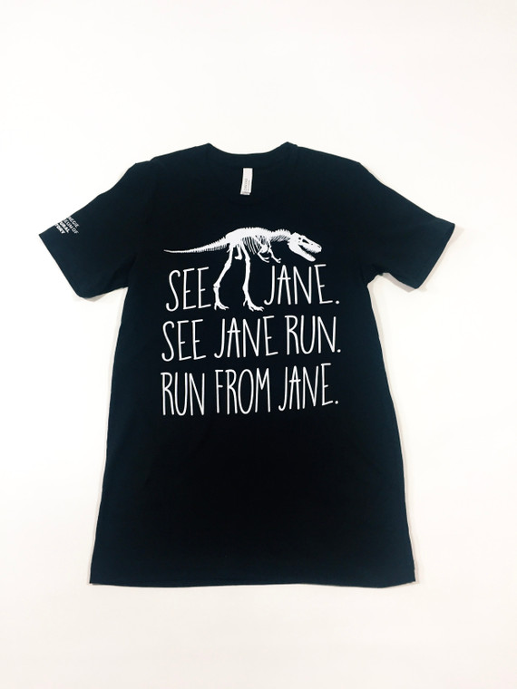 Black unisex t-shirt imprinted in white with a full front Tyrannosaurs Rex Fossil sandwiched between the text See Jane, See Jane run, Run from Jane, with the Carnegie Museum of Natural History logo on the right sleeve.
