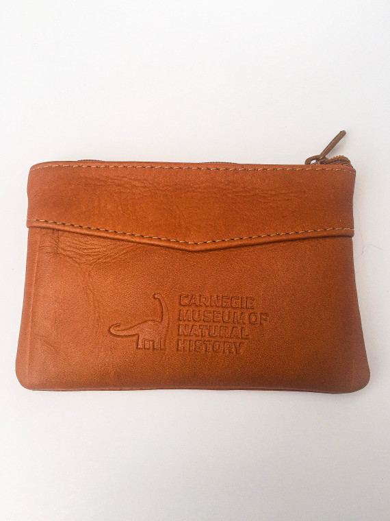 This is a tan leather pouch that opens with a top zipper and embossed with the Carnegie Museum of Natural History logo.