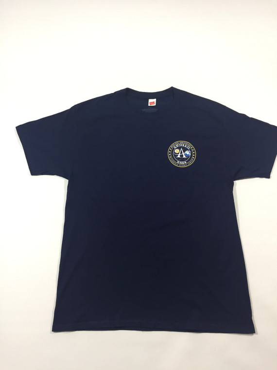 This image shows a navy blue tee shirt with the Apollo anniversary logo on the front left chest.  The back has a large Apollo 50th anniversary image with the Carnegie Science Center logo underneath.