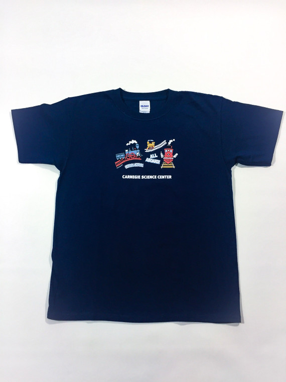 This image shows a navy blue youth tee shirt with 3 youthful train images in blue, red and yellow.  It says all aboard. It has the Carnegie Science Center logo on the sleeve.