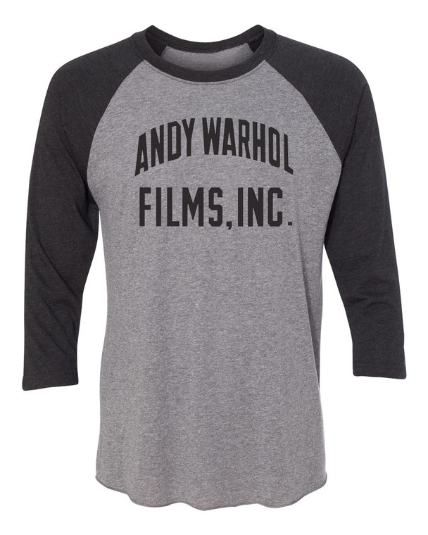 """A 3/4 length sleeve baseball style t-shirt with a heatherd gray body and dark gray sleeves, with the words """"Andy Warhol Films Inc"""" in black"""