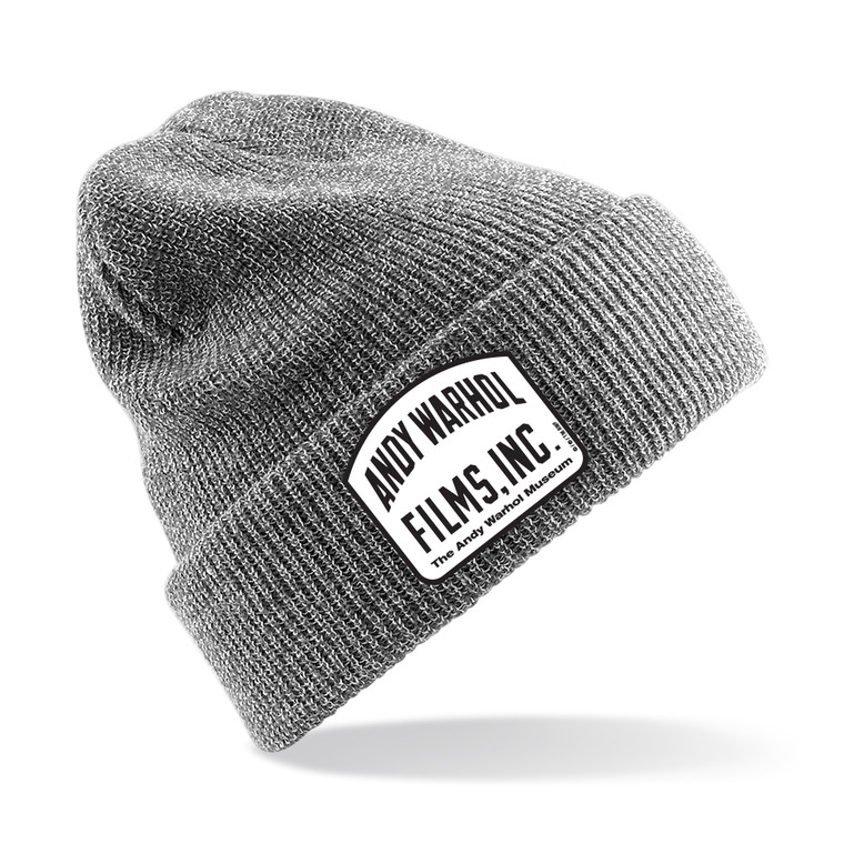 "A heathered gray beanie with a gray and black patch with the words ""Andy Warhol Films Inc"""
