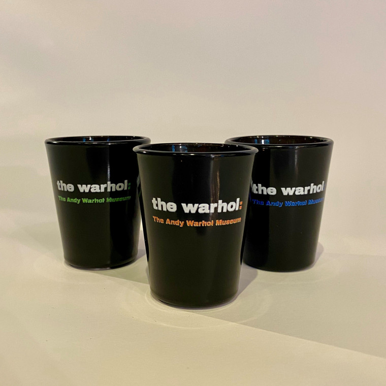 """Three black glass shot glasses with the words """"The Warhol: The Andy Warhol Museum"""""""