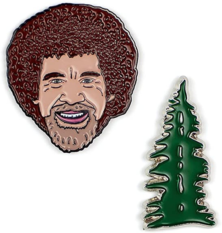 Set of pins featuring beloved artist Bob Ross and his popular Happy Little Tree. Both pins have rubber pin backs to ensure your pins stay in place.