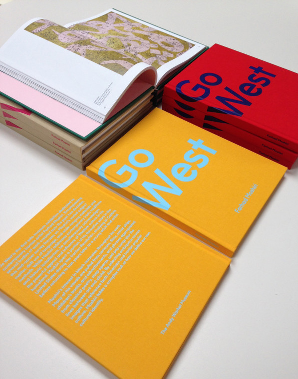 An assortment of book covers in tan, yellow and red
