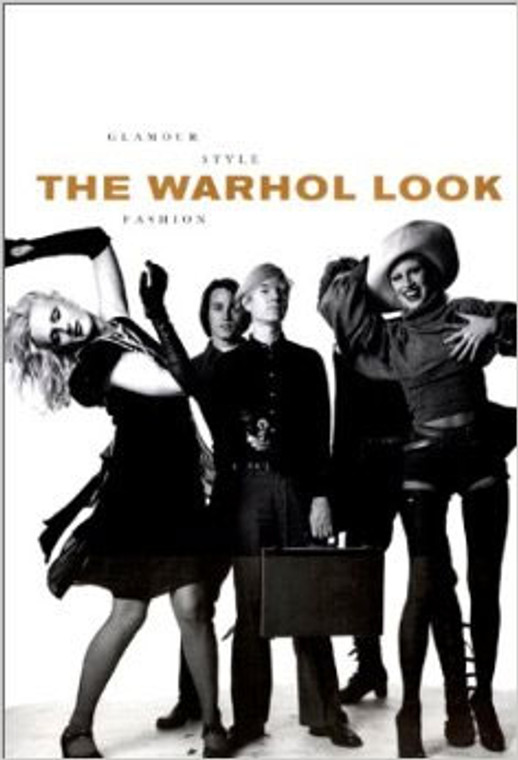 A book cover with a black and white photo of a group of people standing in a row, with Andy Warhol in the center