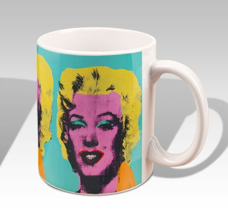 A mock up of a mug with an image of Marilyn Monroe with a pink face and bright yellow hair, on a turquoise background.