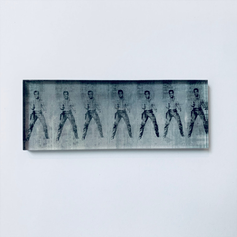 """A photo of an acrylic magnet featuring an image of Warhol's """"Elvis"""" in black on silver"""