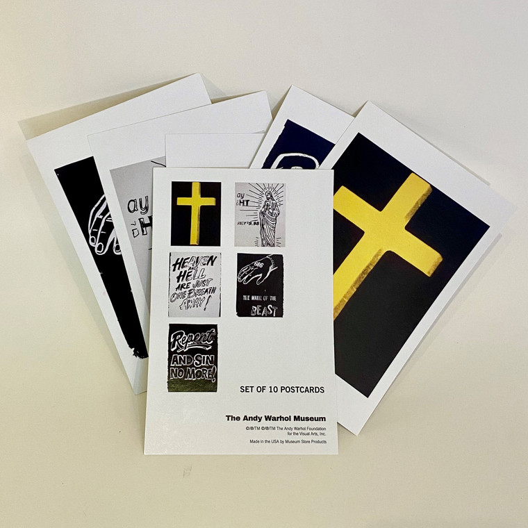 A grouping of postacards of Warhol religious-themed works, mostly in black and white.