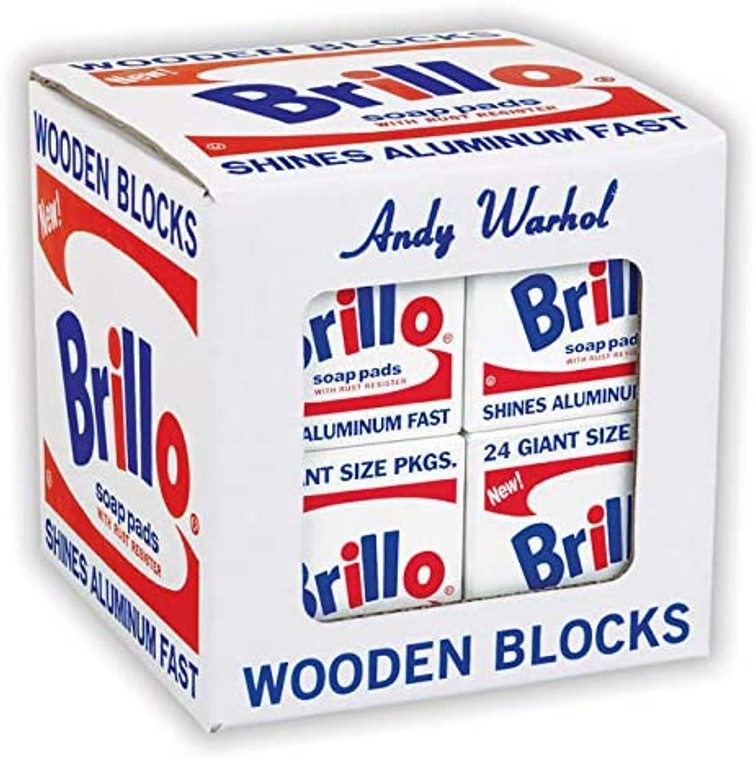 A cube box with Warhol's Brillo artwork in red, white and blue, with a window showing four blocks in the same pattern.