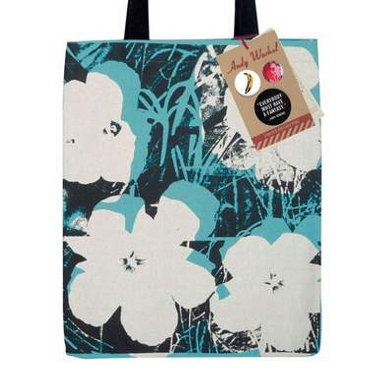 A light blue canvas tote bag with black handles silkscreened with white, black and blue flowers.